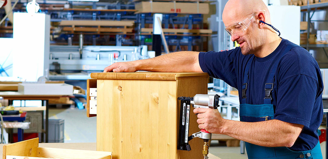 Pneumatic staple guns for working on furniture
